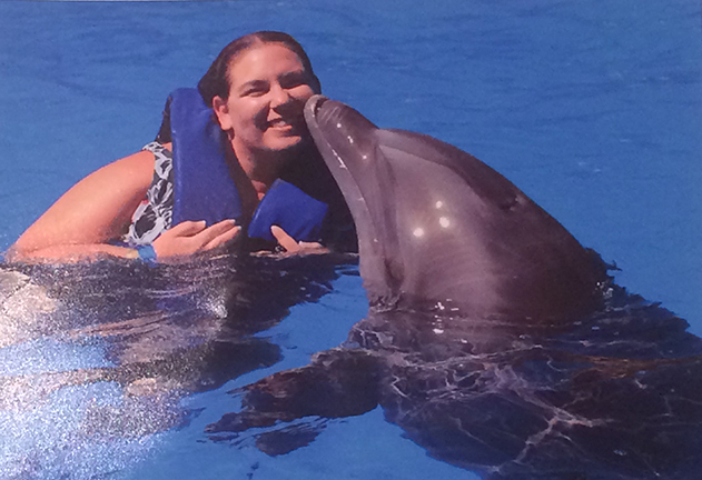 Amy Antonellis gets a smooch from a dolphin